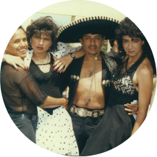 Five Latino people dressed for the 1991 Orange County Gay Pride Festival 1991