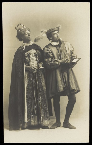 Download the full-sized image of Actors in pantomime in Brighton: S. West playing King Robert of Remlaf and H. Taylor in drag as Queen Aggie of Remlaf. Photographic postcard.
