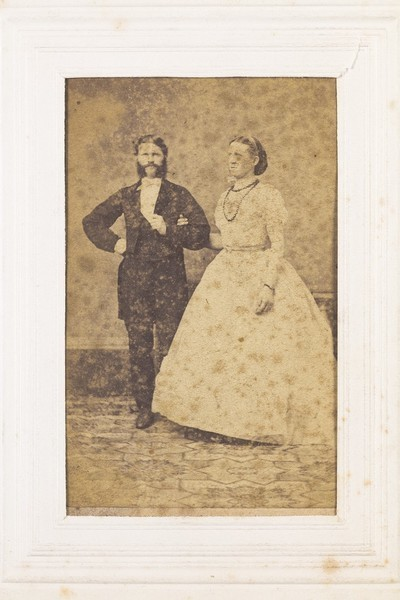 Download the full-sized image of Two men, one in drag, posing as a couple. Photograph, 189-.