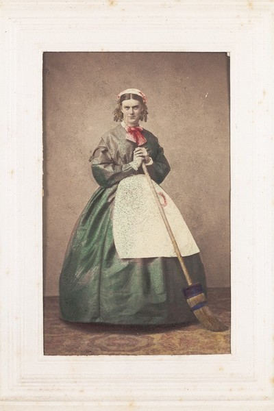 Download the full-sized image of A man in drag holding a broom. Photograph, 1862.