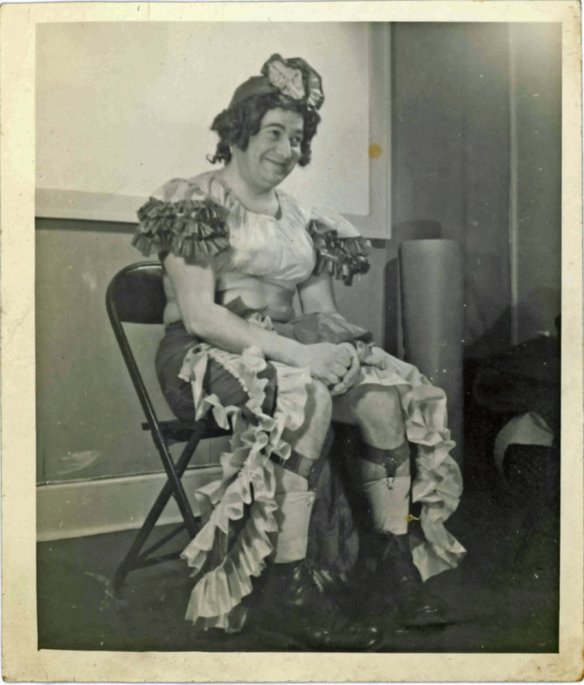 Download the full-sized PDF of A Seated Performer Poses for a Photograph