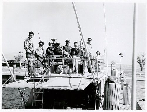 Download the full-sized image of Christine Jorgensen Poses on a Boat with Eight Others
