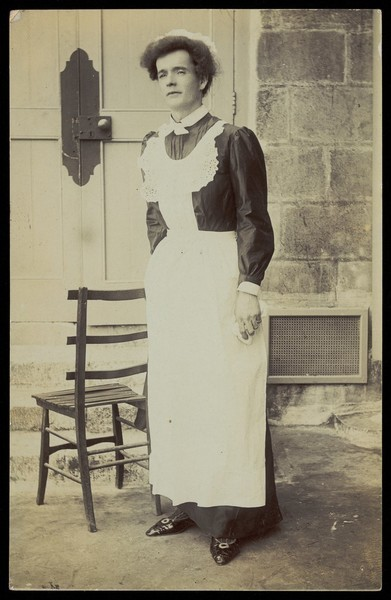 Download the full-sized image of An man dressed as a parlour-maid. Photographic postcard, ca. 1910.