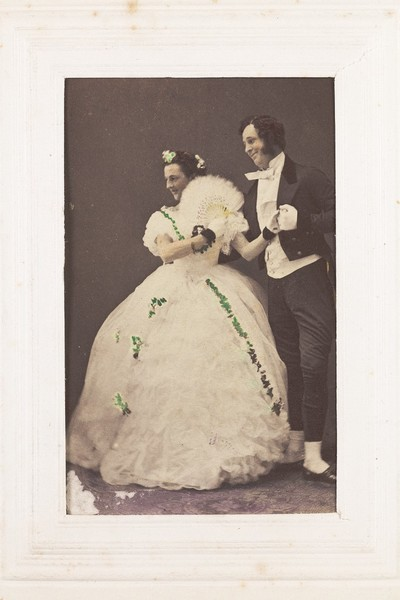 Download the full-sized image of Two men, one in drag, posing as a performing couple. Photograph, 189-.