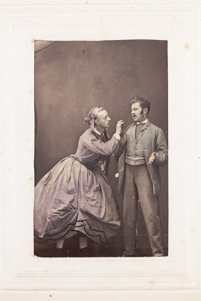 Download the full-sized image of Two men, one in drag, posing in disagreement. Photograph, 189-.
