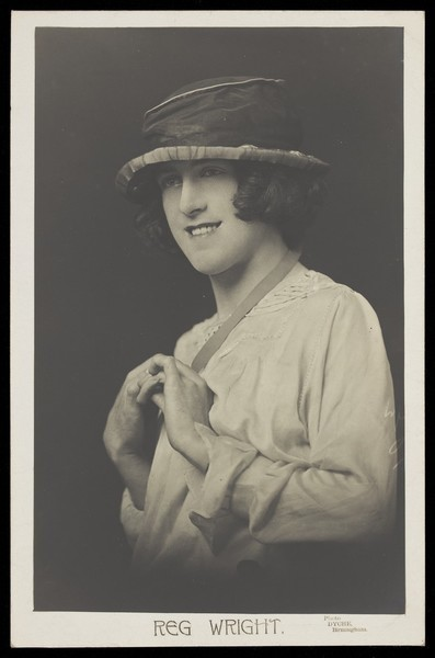 Download the full-sized image of Reg Wright in drag. Photographic postcard by Dyche, 19--.