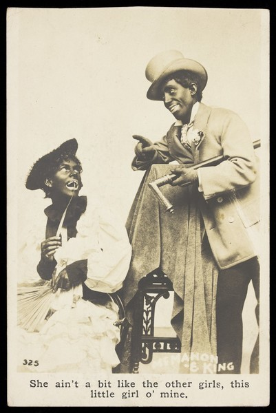 Download the full-sized image of McMahon and King, two actors made up as blackface minstrels, with King in drag. Photographic postcard, 191-.