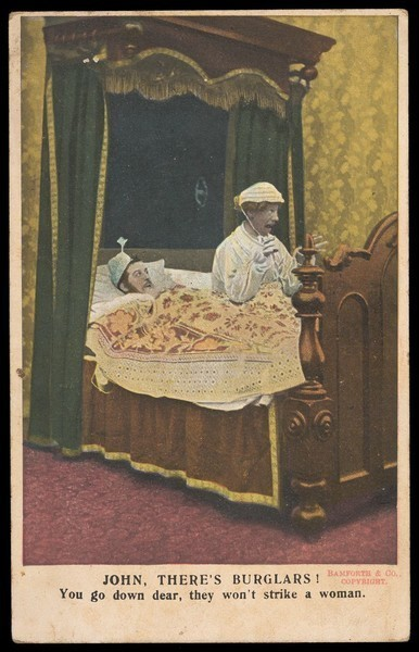 Download the full-sized image of Two men in bed, one in drag: they have been woken up by the sound of burglars. Colour lithograph, 191-.