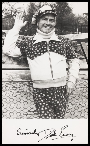 Download the full-sized image of Dick Emery waving in a park. Photograph, 197-.